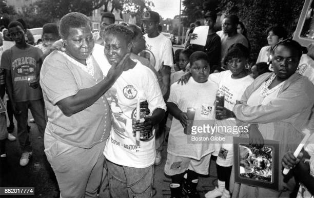 Betty Johnson left and Judy Rogers who both lost sons to police bullets support each other during a candlelight vigil on Hamilton Street in the...