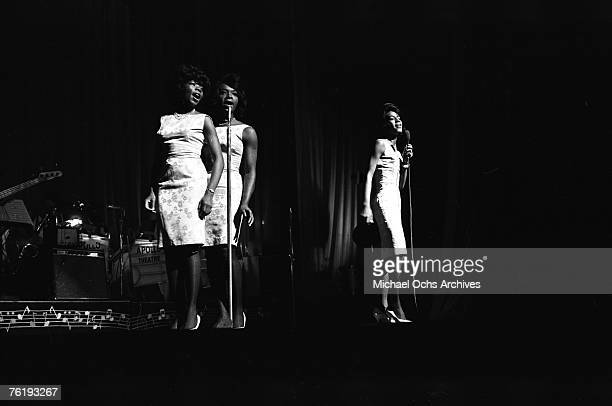 Betty Kelly Rosalind Ashford and Martha Reeves of Martha and the Vandellas perform circa mid1964 at the Apollo Theater in Harlem New York