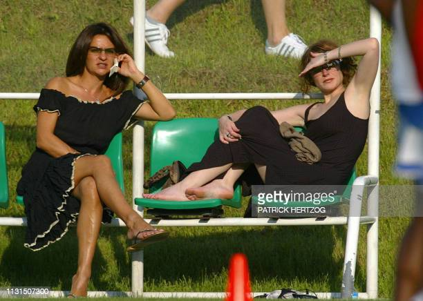 Betty Leboeuf the wife of French defencer Frank Leboeuf and Elsa the girlfriend of French defender Bixente Lizarazu look at a training session of the...