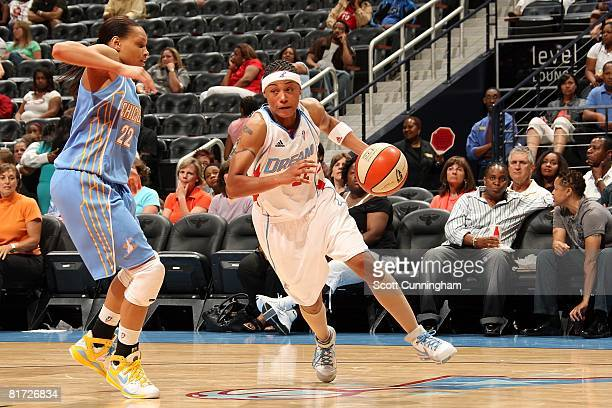 Betty Lennox of the Atlanta Dream drives against Armintie Price of the Chicago Sky during the WNBA game on June 6 2008 at Philips Arena in Atlanta...