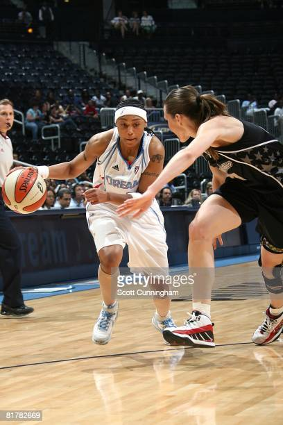 Betty Lennox of the Atlanta Dream drives against Erin Buescher of the San Antonio Silver Stars during the WNBA game on June 18 2008 at Philips Arena...