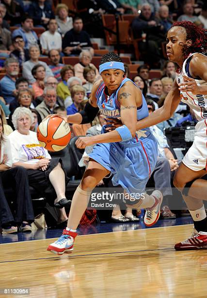 Betty Lennox of the Atlanta Dream drives against the Connecticut Sun during the WNBA game on May 17, 2008 at the Mohegan Sun Arena in Uncansville,...