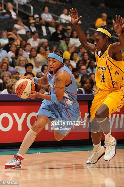 Betty Lennox of the Atlanta Dream drives to the basket against Marie Ferdinand-Harris of the Los Angeles Sparks on September 11, 2008 at Staples...