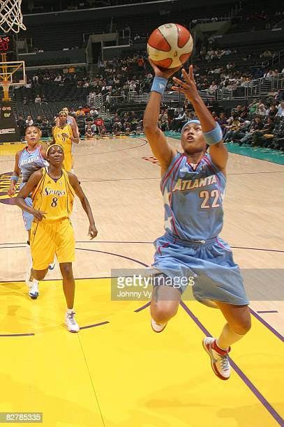 Betty Lennox of the Atlanta Dream goes up for a layup while DeLisha MiltonJones of the Los Angeles Sparks watches during a game on September 11 2008...