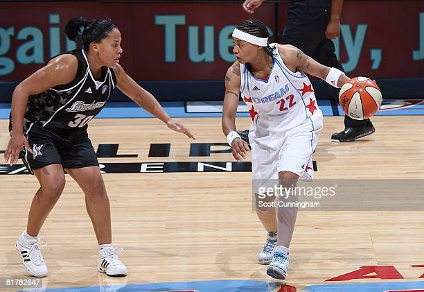 Betty Lennox of the Atlanta Dream looks to maneuver against Helen Darling of the San Antonio Silver Stars during the WNBA game on June 18 2008 at...