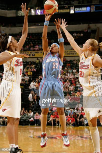 Betty Lennox of the Atlanta Dream shoots over Tammy SuttonBrown and Katie Douglas of the Indiana Fever at Conseco Fieldhouse on August 30 2008 in...