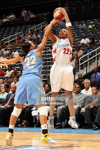 Betty Lennox of the Atlanta Dream takes a jump shot under pressure against Armintie Price of the Chicago Sky during the WNBA game on June 6 2008 at...