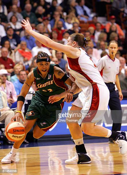 Betty Lennox of the Seattle Storm drives against Lindsay Whalen of the Connecticut Sun in Game 1 of the WNBA Finals on October 8, 2004 at the Mohegan...