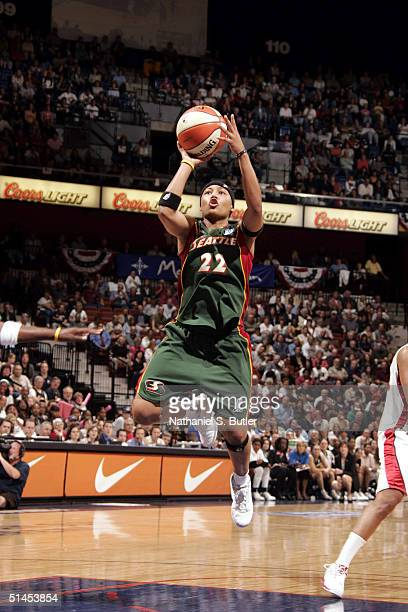 Betty Lennox of the Seattle Storm shoots against the Connecticut Sun during Game 1 of the 2004 WNBA Finals on October 8, 2004 at Mohegan Sun Arena in...