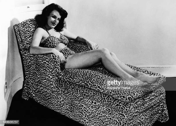 Betty Paulik dressed in a swimsuit leopardprinted velvet on a chaise lounge of the same pattern at the American Furniture Mart where the trends in...