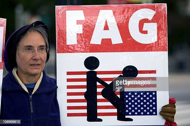 Betty Phelps a member of Westboro Baptist Church from Topeka Kansas holds antigay banners with other church members in front of the US Supreme Court...