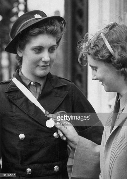 Betty Quinn the youngest recipient of the George Medal at the Investiture Ceremony at Buckingham Palace London She saved seven people from a bombed...