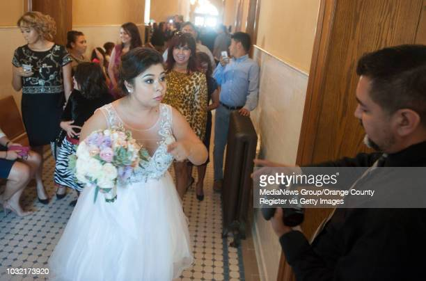 Betty Ramos of Bellflower checks with David Cabrera PIO for ClerkRecorder Hugh Nguyen before marrying Anthony Jackson at the Old County Courthouse in...
