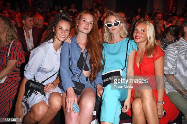 Betty Taube, Jana Heinisch, Kim Hnizdo and Evelyn Burdecki attend the Guido Maria Kretschmer fashion show during the Berlin Fashion Week...