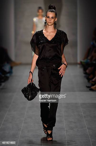 Betty Taube walks the runway at the Guido Maria Kretschmer show during the MercedesBenz Fashion Week Spring/Summer 2015 at Erika Hess Eisstadion on...