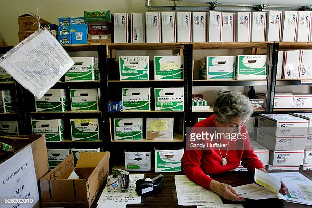 Betty Tenney reads requests for items from military personel before loading care packages to be sent to troops overseas in a garage at the La Costa...