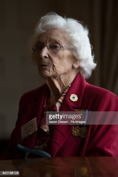 Betty Webb a typist during WWII and later a recruiter for the army displays her medals as veterans reunite returning to the scene of their wartime...