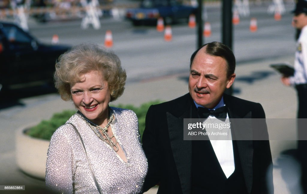 Betty White and John Hillerman arrive at The 37th Primetime Emmy Awards on September22, 1985 at Pasadena Civic Auditorium, Pasadena, California.