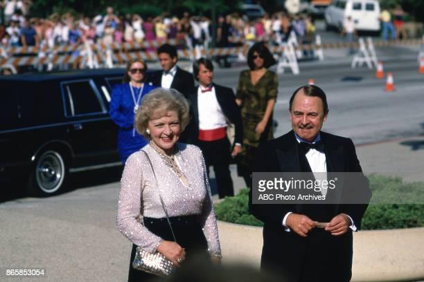 Betty White and John Hillerman arrive at The 37th Primetime Emmy Awards on September22 1985 at Pasadena Civic Auditorium Pasadena California