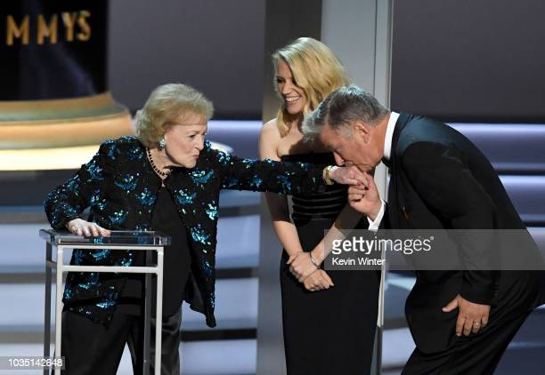 Betty White Kate McKinnon and Alec Baldwin speak onstage during the 70th Emmy Awards at Microsoft Theater on September 17 2018 in Los Angeles...