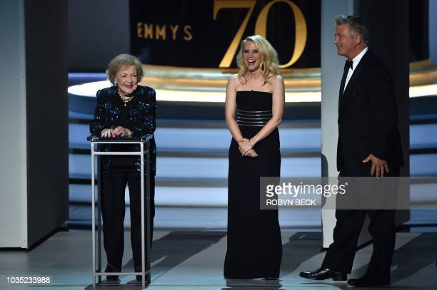 Betty White Kate McKinnon and Alec Baldwin speak onstage during the 70th Emmy Awards at the Microsoft Theatre in Los Angeles California on September...