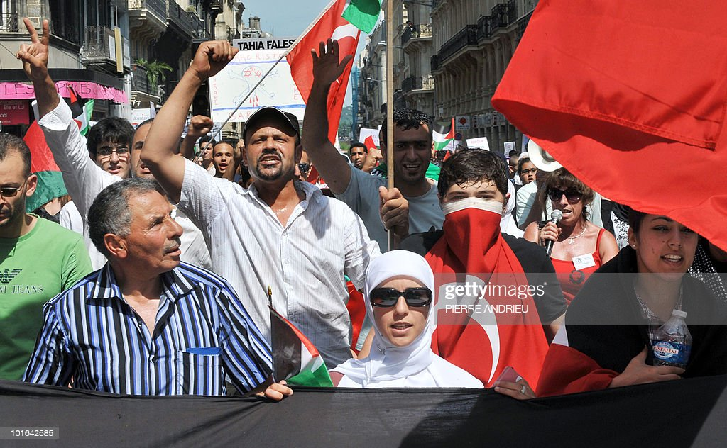 Between five hundred and one thousand people protest with a Palestinian flag on June 5, 2010 in Bordeaux, southern France, during a demonstration to protest against Israeli's storming of a Gaza-bound aid flotilla that left nine pro-Palestinian activits dead.