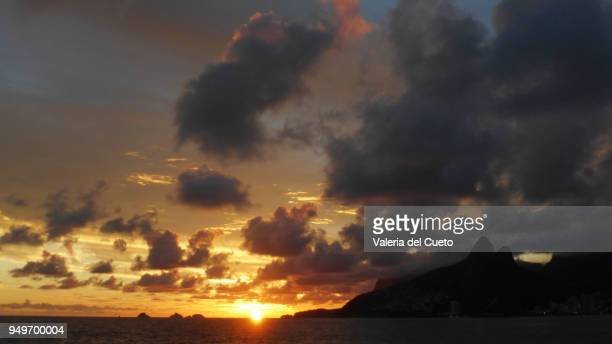 between islands and coast, the sunset from ipanema - sem fim... valéria del cueto stock pictures, royalty-free photos & images