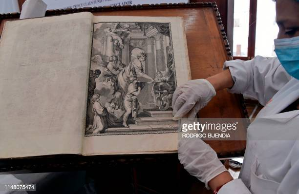 Bety Costales restorer of Conservartecuador foundation shows one of the polyglot bibles of the Fray Ignacio de Quezada library at the Convent of...