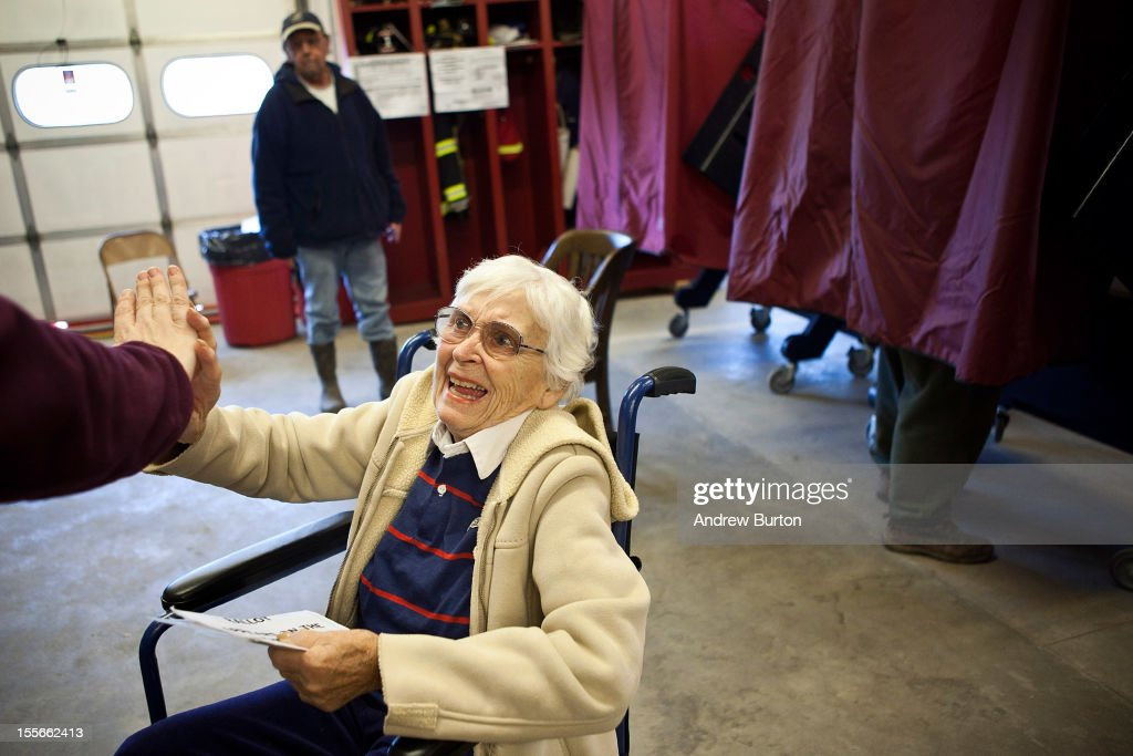 Bety Etzel high-fives her daughter-in-law after voting in the presidential election in Bay Head Fire Station 14 on November 6, 2012 in Bay Head, New Jersey. As the New Jersey coastline continues to recover from Superstorm Sandy, numerous polling stations have had to be merged and relocated due to storm damage and power outages.