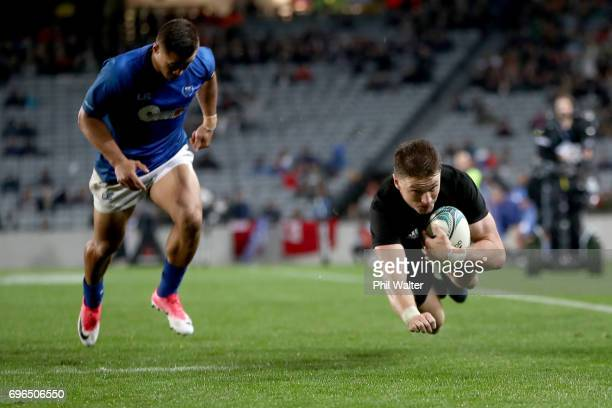 Beuden Barrett of the All Blacks scores a try during the International Test match between the New Zealand All Blacks and Samoa at Eden Park on June...