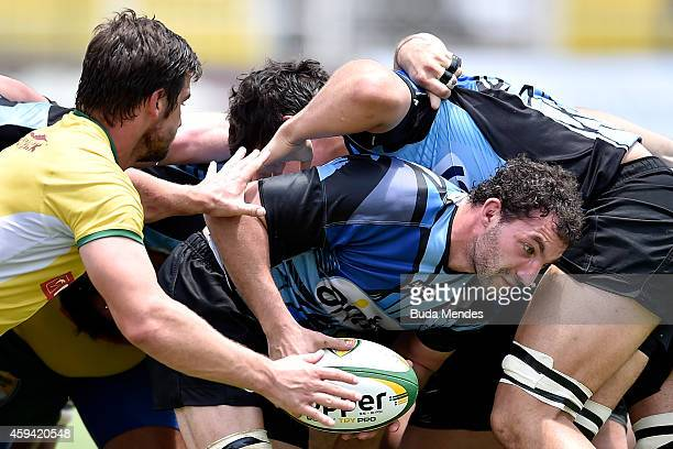 Beukes Cremer of Brazil fights for the ball with a Mathias Braun of Uruguay during the Rugby XV International Friendly between Brazil and Uruguay at...