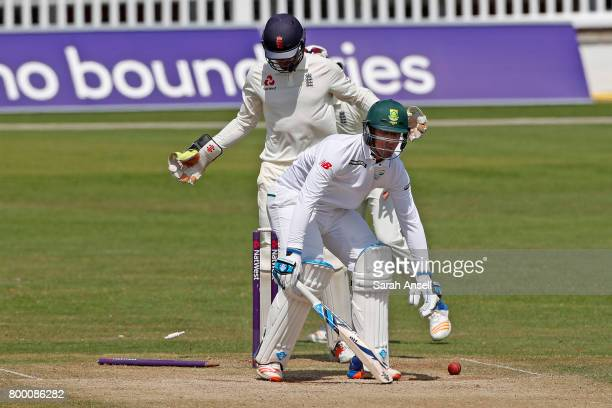 Beuran Hendricks of South Africa A is bowled as England Lions wicket keeper Ben Foakes looks on during day 3 of the match between England Lions and...