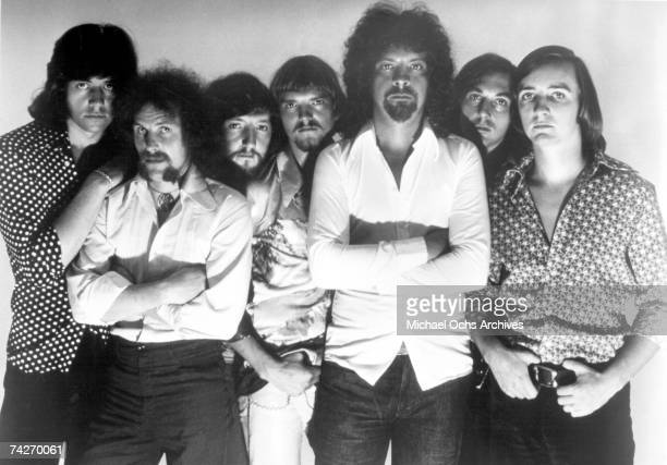 Bev Bevan Kelly Groucutt Mik Kaminsky Colin Walker Jeff Lynne Melvyn Gale and Richard Tandy of Electric Light Orchestra pose for a portrait in 1975