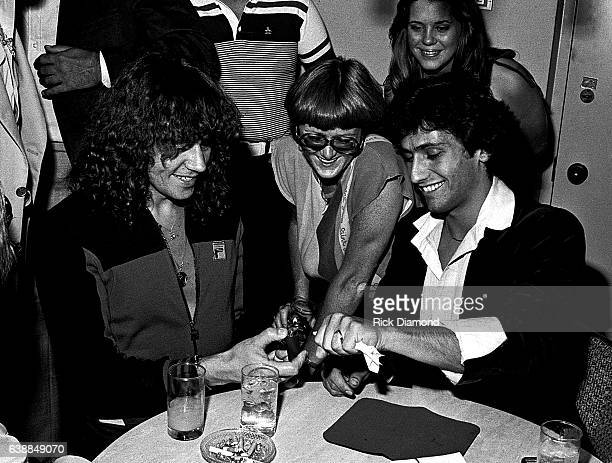 Bev Bevan of ELO and guests are entertained by Magician Bob Dubek during ELO press reception at the Peachtree Plaza in Atlanta Georgia July 06 1978