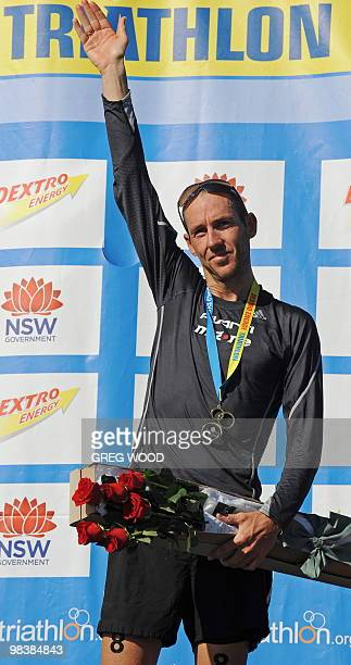 Bevan Docherty of New Zealand waves from the victory podium following the finish of the men's section at the Sydney round of the ITU World...