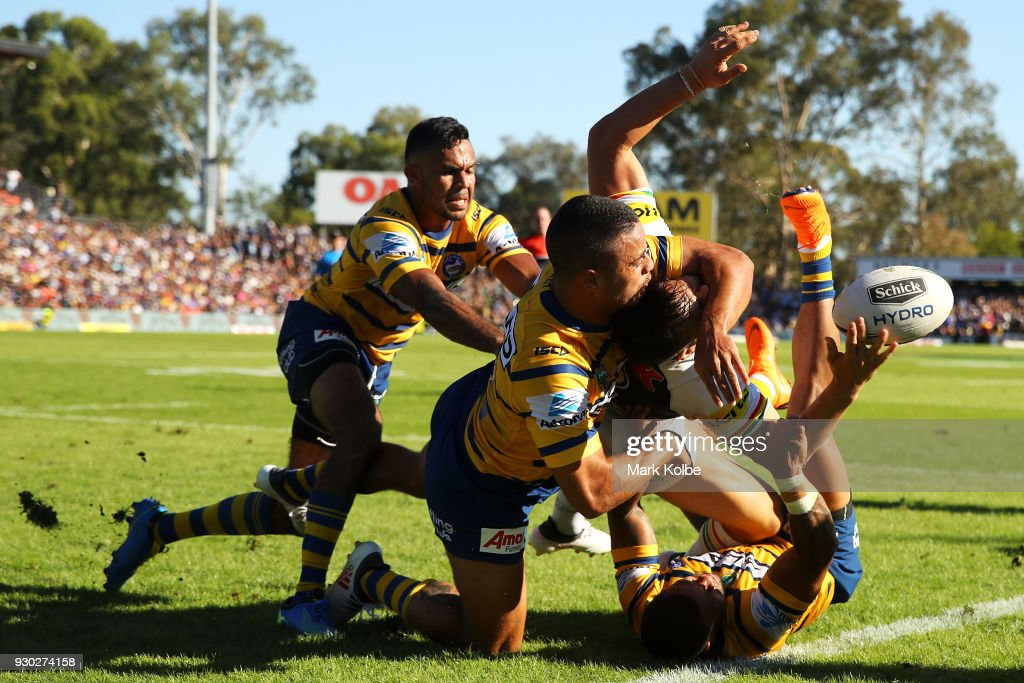 Bevan French, Jarryd Hayne and Josh Hoffman of the Eels tackle Josh Mansour of the Panthers into touch during the round one NRL match between the Penrith Panthers and the Parramatta Eels at Panthers Stadium on March 11, 2018 in Sydney, Australia.