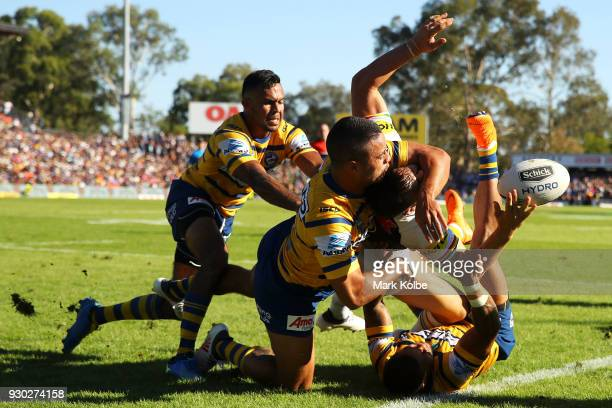 Bevan French Jarryd Hayne and Josh Hoffman of the Eels tackle Josh Mansour of the Panthers into touch during the round one NRL match between the...