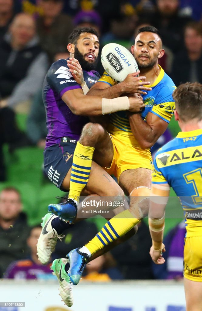 Bevan French of the Eels and Josh Addo-Carr of the Storm compete for the ball during the round 18 NRL match between the Melbourne Storm and the Parramatta Eels at AAMI Park on July 8, 2017 in Melbourne, Australia.
