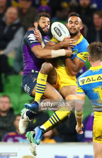 Bevan French of the Eels and Josh AddoCarr of the Storm compete for the ball during the round 18 NRL match between the Melbourne Storm and the...