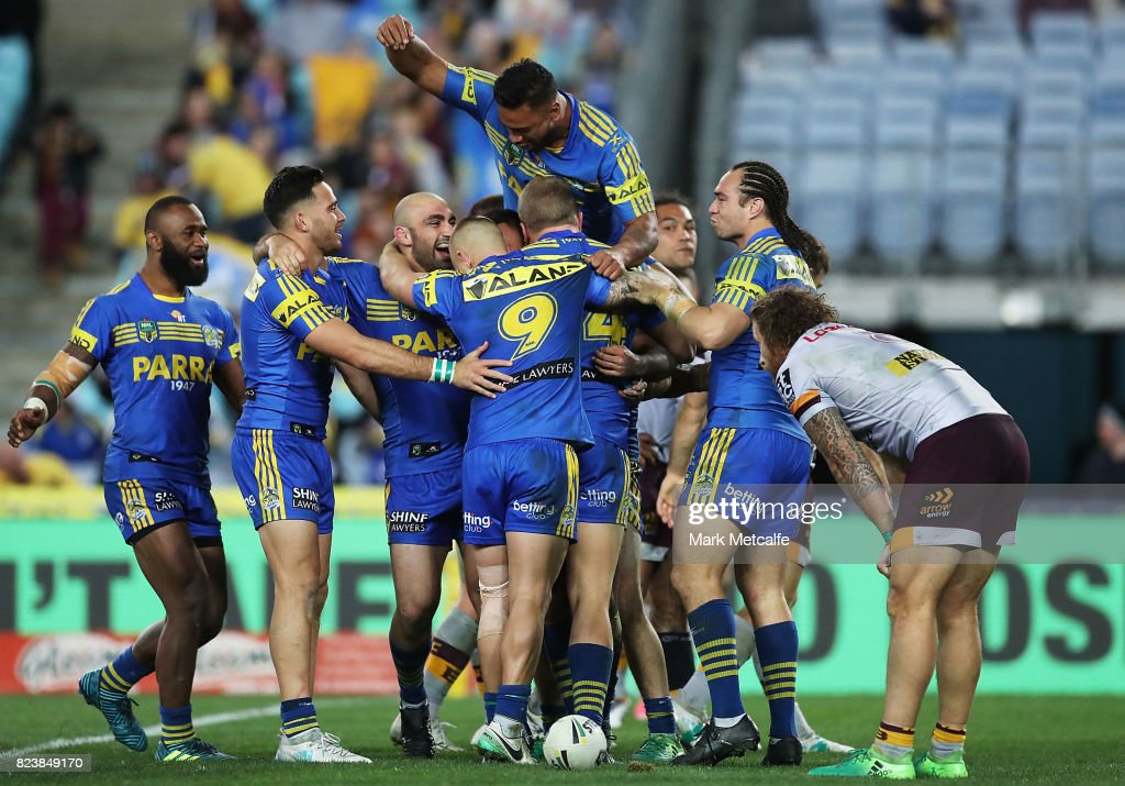 Bevan French of the Eels celebrates scoring a try with team mates during the round 21 NRL match between the Parramatta Eels and the Brisbane Broncos at ANZ Stadium on July 28, 2017 in Sydney, Australia.