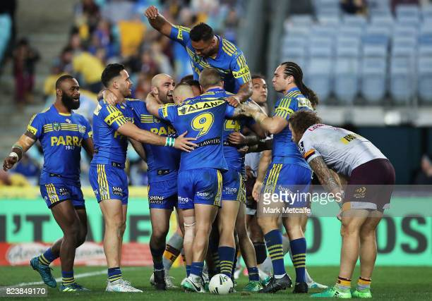 Bevan French of the Eels celebrates scoring a try with team mates during the round 21 NRL match between the Parramatta Eels and the Brisbane Broncos...