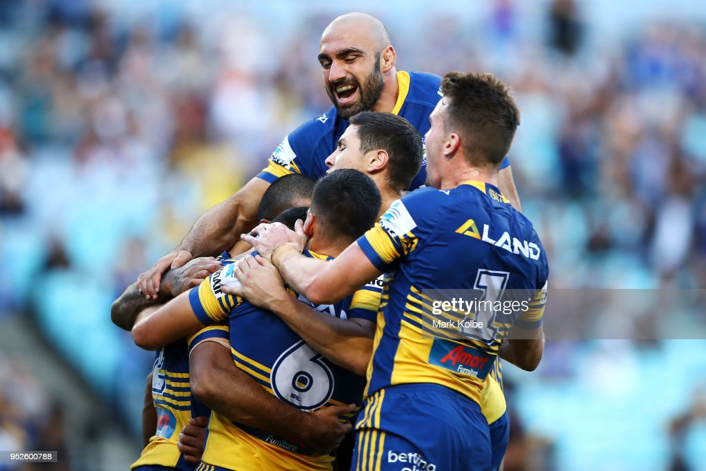 Bevan French of the Eels celebrates with his team mates after scoring a try during the round Eight NRL match between the Parramatta Eels and the Wests Tigers at ANZ Stadium on April 29, 2018 in Sydney, Australia.
