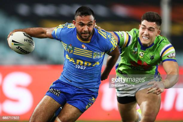 Bevan French of the Eels evades Nikola Cotric of the Raiders during the round 11 NRL match between the Parramatta Eels and the Canberra Raiders at...