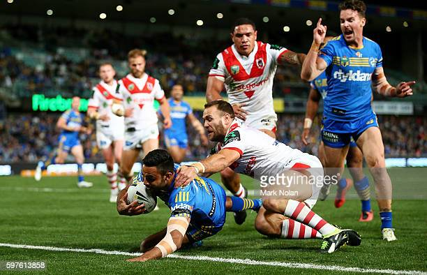 Bevan French of the Eels heads for the try line to score during the round 25 NRL match between the Parramatta Eels and the St George Illawarra...