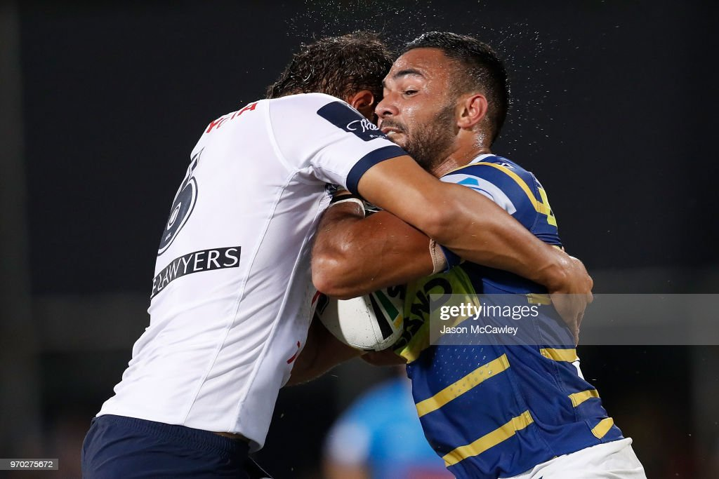 Bevan French of the Eels is tackled during the round 14 NRL match between the Parramatta Eels and the North Queensland Cowboys at TIO Stadium on June 9, 2018 in Darwin, Australia.