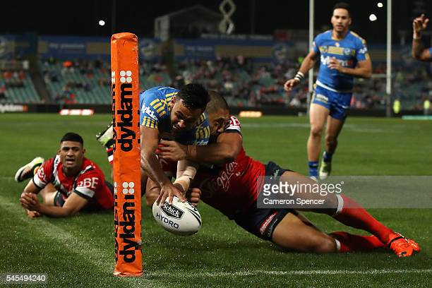 Bevan French of the Eels is tackled over the sideline as he attempts to score a try during the round 18 NRL match between the Parramatta Eels and the...