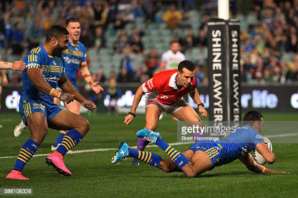 Bevan French of the Eels scores a try during the round 22 NRL match between the Parramatta Eels and the Manly Sea Eagles at Pirtek Stadium on August...