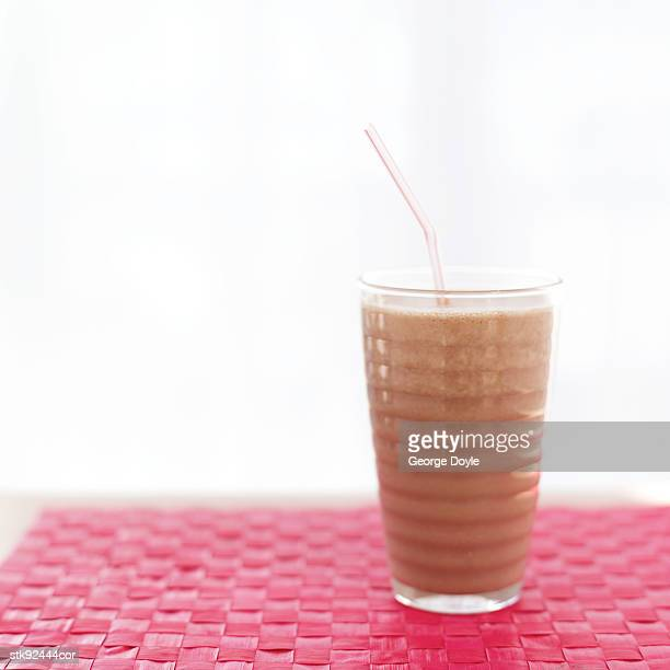 beverage in a glass with a straw