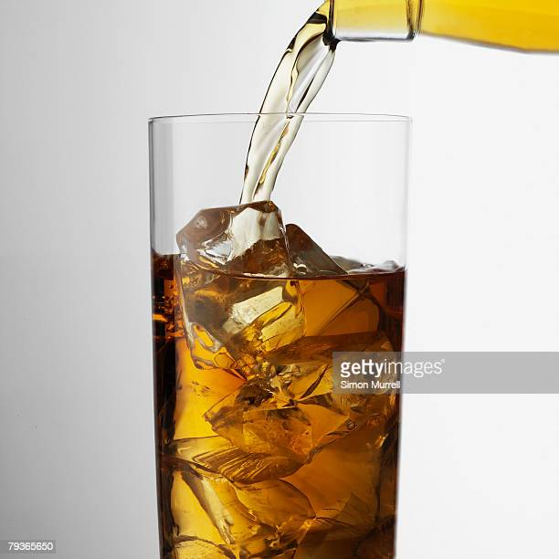 Beverage indoors being poured into glass