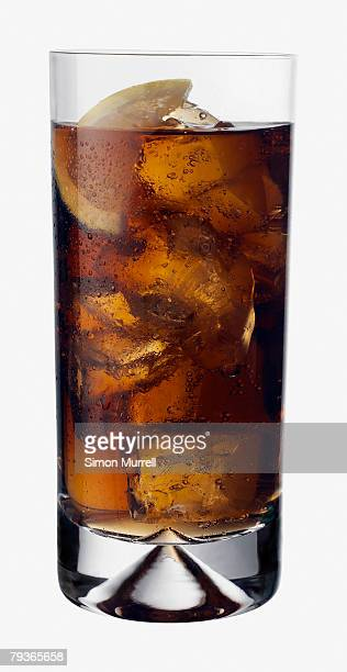 Beverage indoors with lime slice and ice